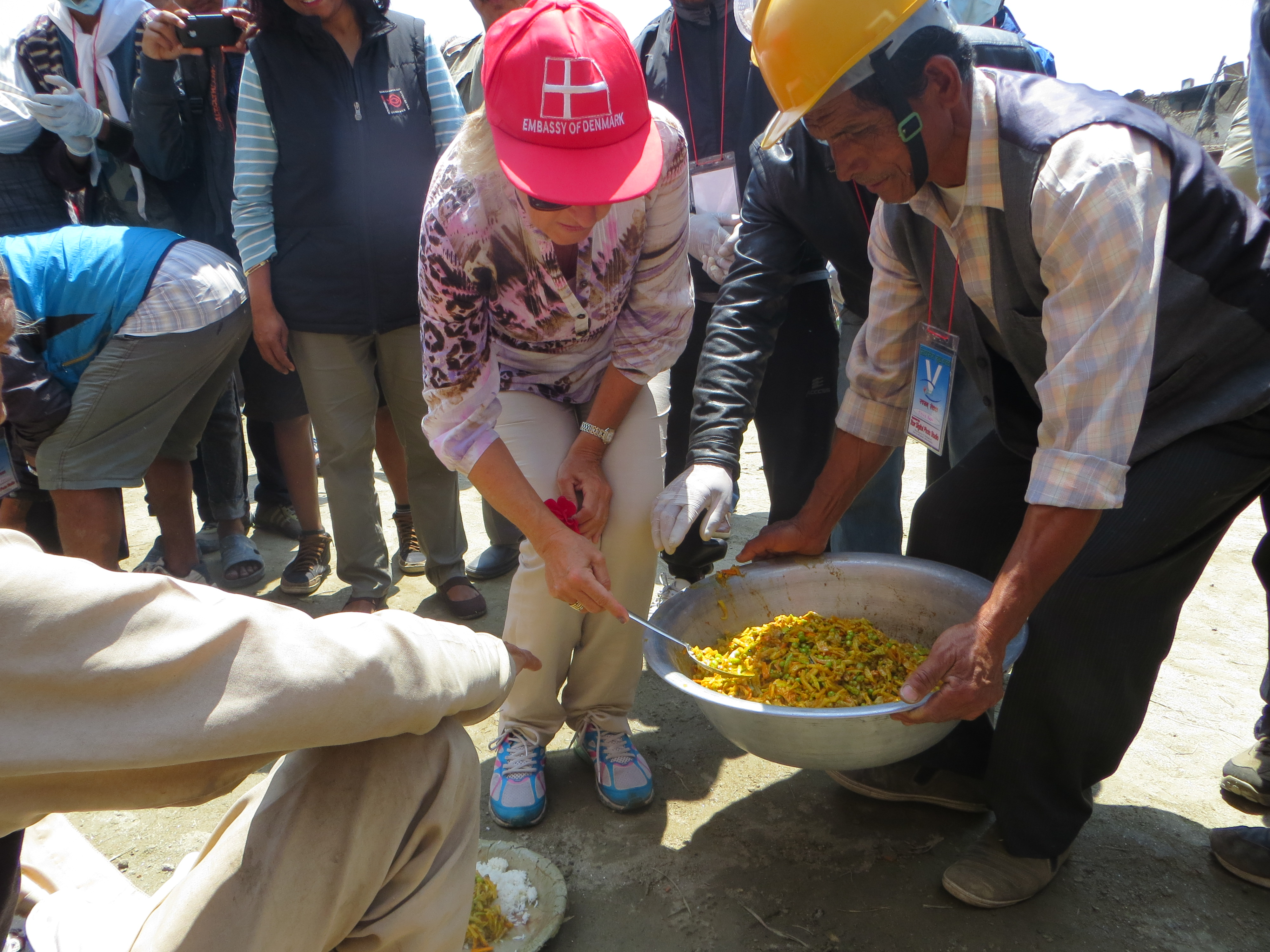 Danish ambassador to Nepal Mrs. H.E. Kirsten Geelan serving food in Nikosera, Bhaktapur under meal feeding program for Earthquake victim.